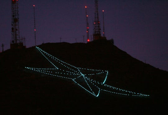 """04/03/2012 The Star on the Mountain shines blue in recognition of Autism Awareness Month. The Autism Community Network of El Paso led the effort. """"It was a long time coming for El Paso,"""" said David Taylor, the network's founder and executive director. """"It raises awareness much more than a T-shirt does."""""""