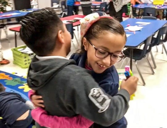 Antonella Nuñez, right, hugs a classmate in their first-grade classroom at Dr. Sue Shook Elementary School in far East El Paso. They demonstrated the hugs they give each other at the end of each school day.