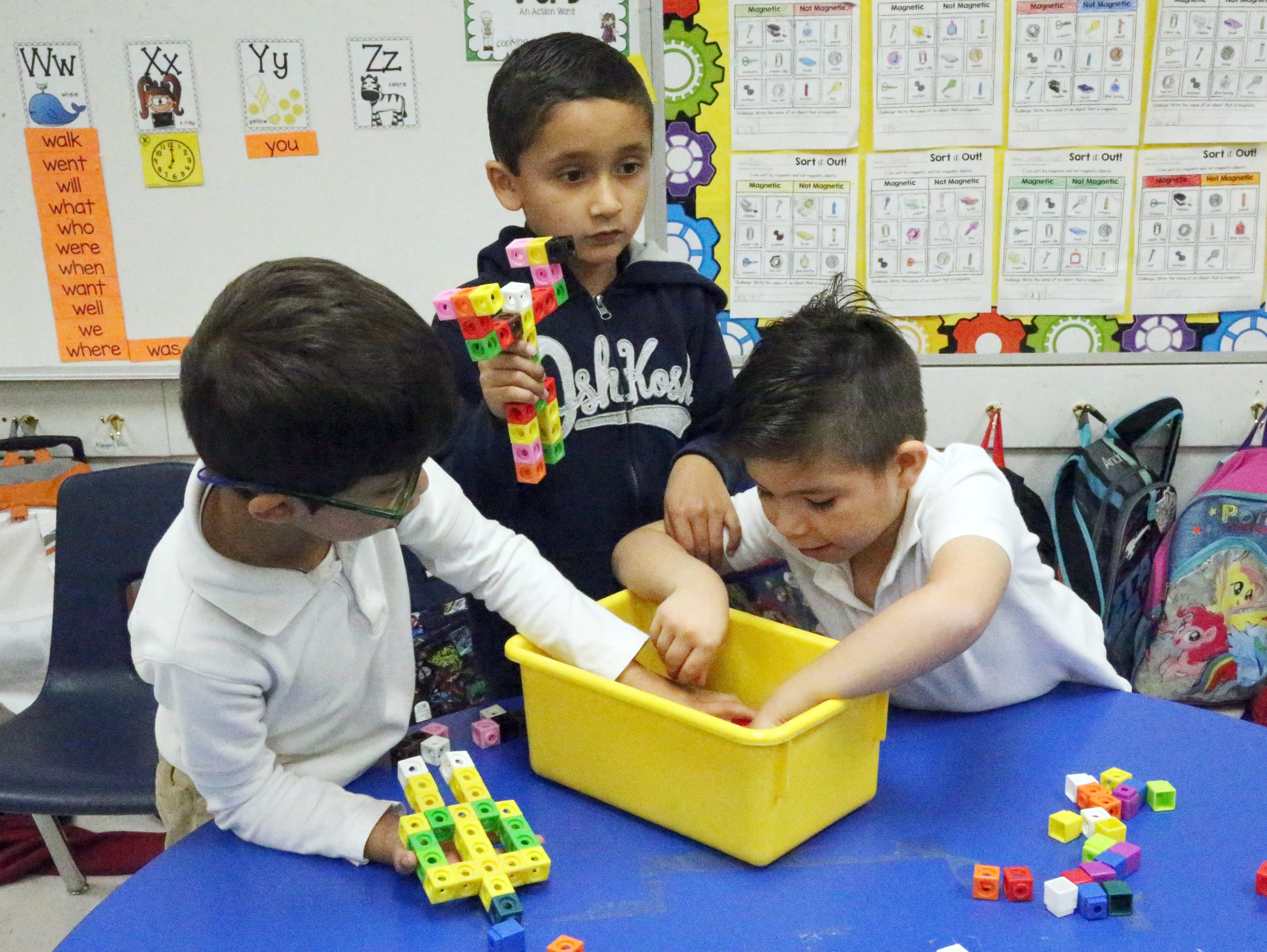 Children do activities with small building cubes in Zelene Blancas' first grade class at Dr. Sue Shook Elementary School.