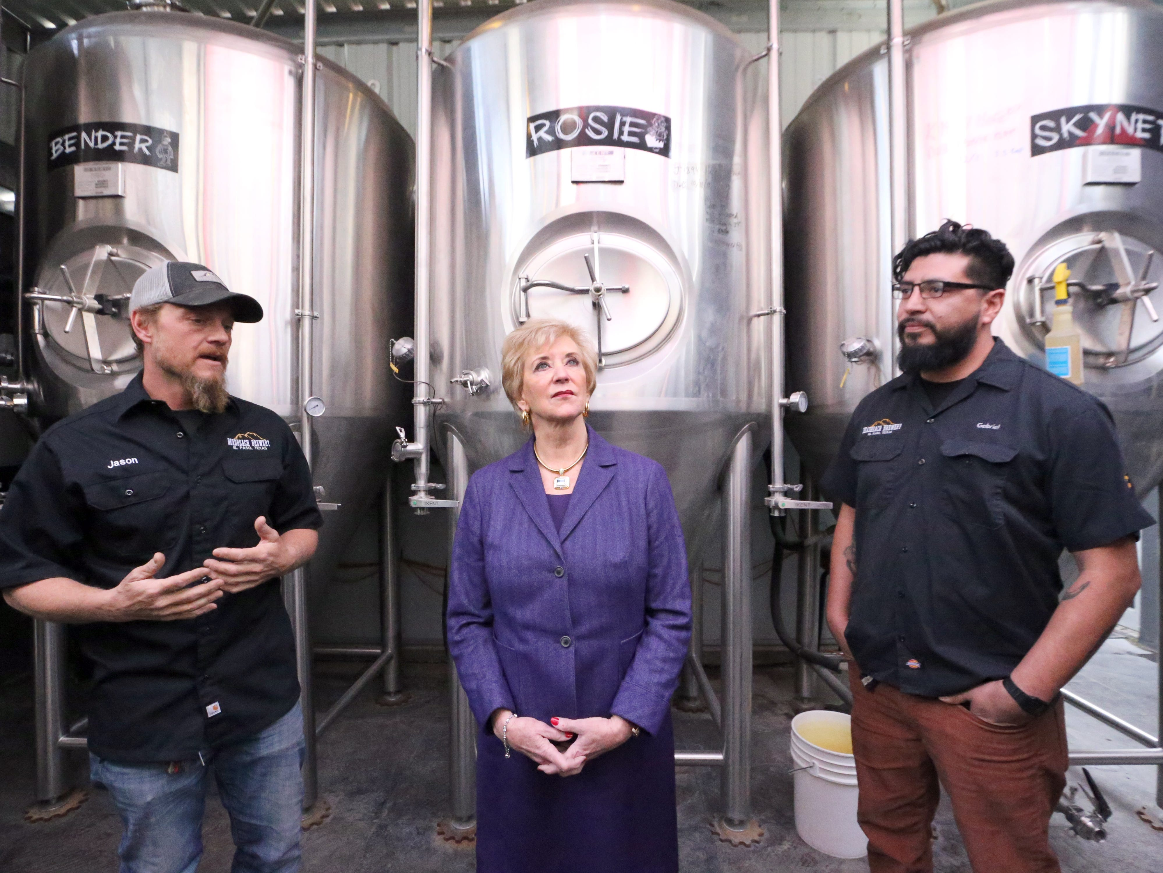 U.S. Small Business Administration director Linda McMahon, center, takes a tour of DeadBeach Brewery at 406 Durango Street with co-owners Jason Hunt, left, and Gabriel Montoya during a visit to El Paso Tuesday. Not pictured is co-owner Justin Ordoñez.