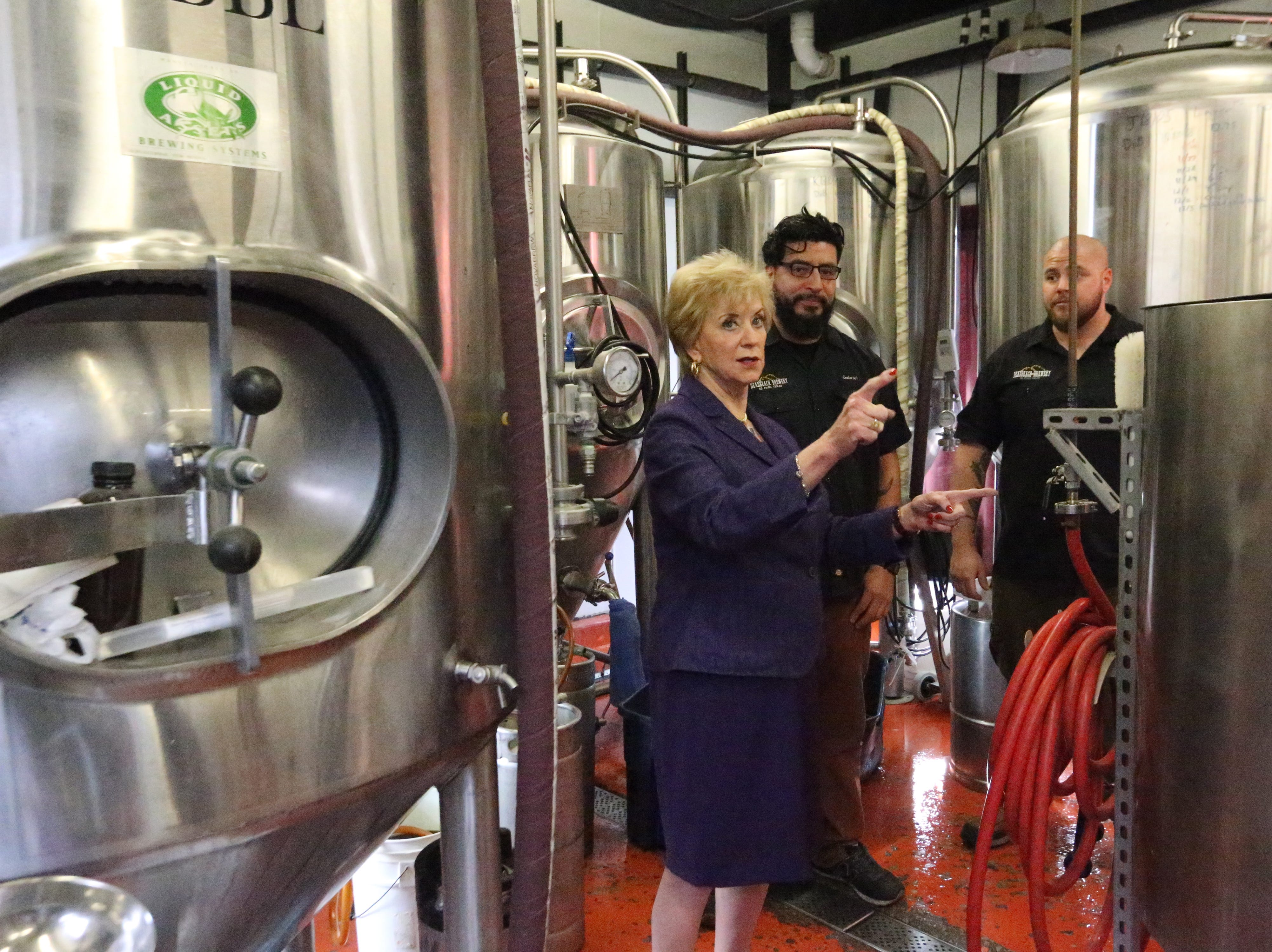 U.S. Small Business Administration director Linda McMahon, center, takes a tour of DeadBeach Brewery at 406 Durango Street during a visit to El Paso Tuesday.