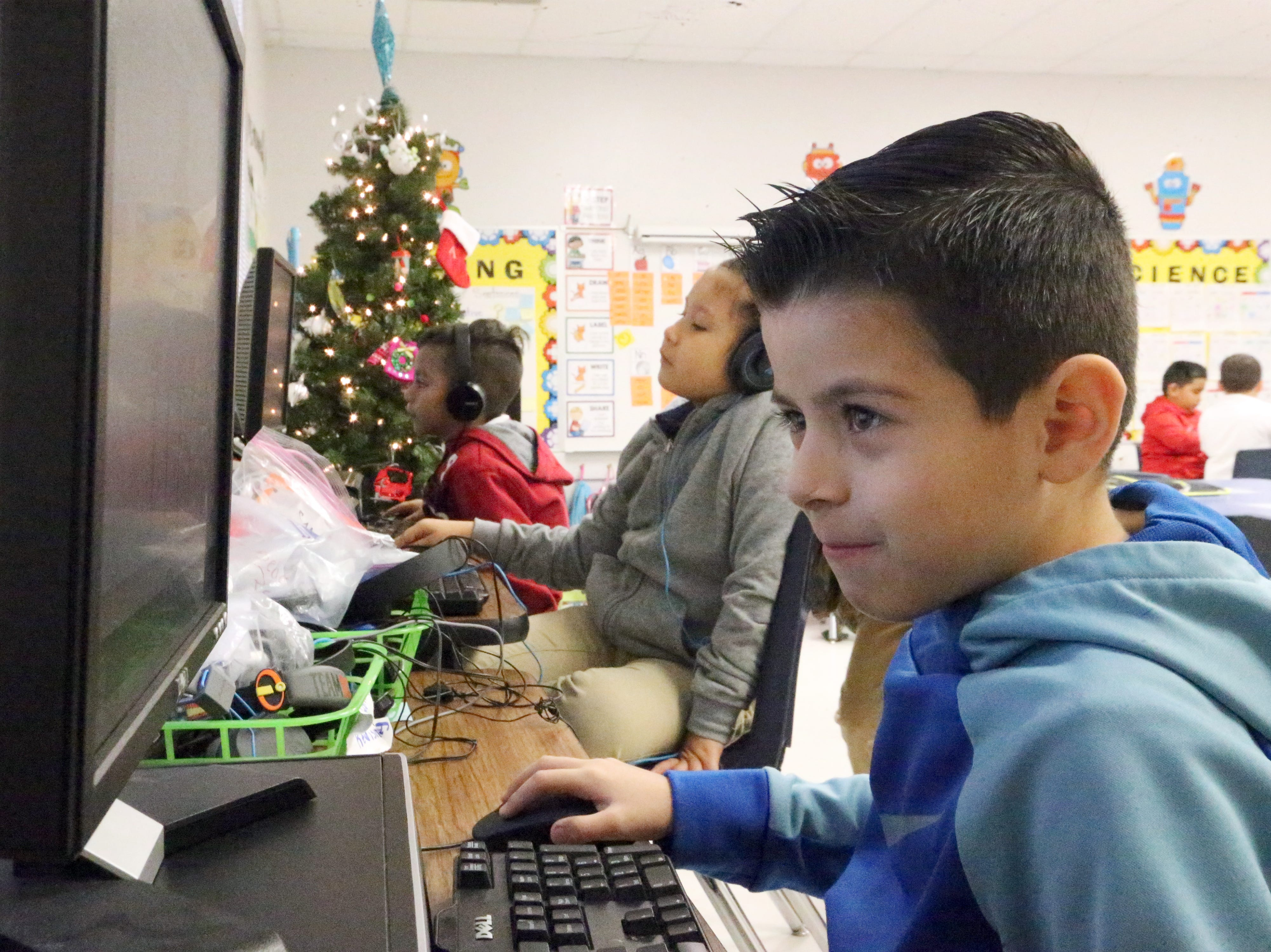 Diego Rodriguez works on a computer program in the classroom of first grade teacher Zelene Blancas at Dr. Sue Shook Elementary School in far East El Paso.
