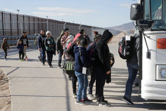 A large group of migrants were detained by Border Patrol Monday at the border fence along the Border Highway near Fonseca. Here the final group that was detained boards a Border Patrol bus for transport to the El Paso Border Patrol detention facility.