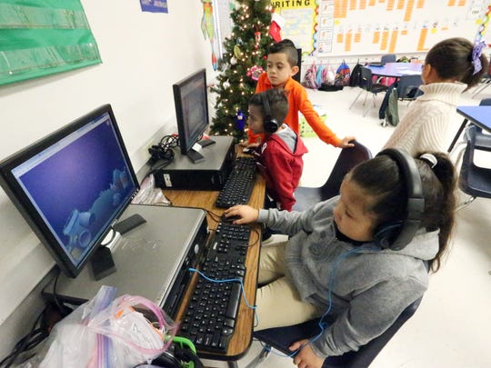 First-grade students in Zelene Blancas' class work on various activities at Dr. Sue Shook Elementary School. The students are in a video their teacher posted on Twitter that has gone viral.