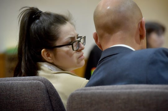 Mayra Chavez, of Oxnard, whispers to her attorney during her trial Monday. She has pleaded not guilty to second-degree murder charges.