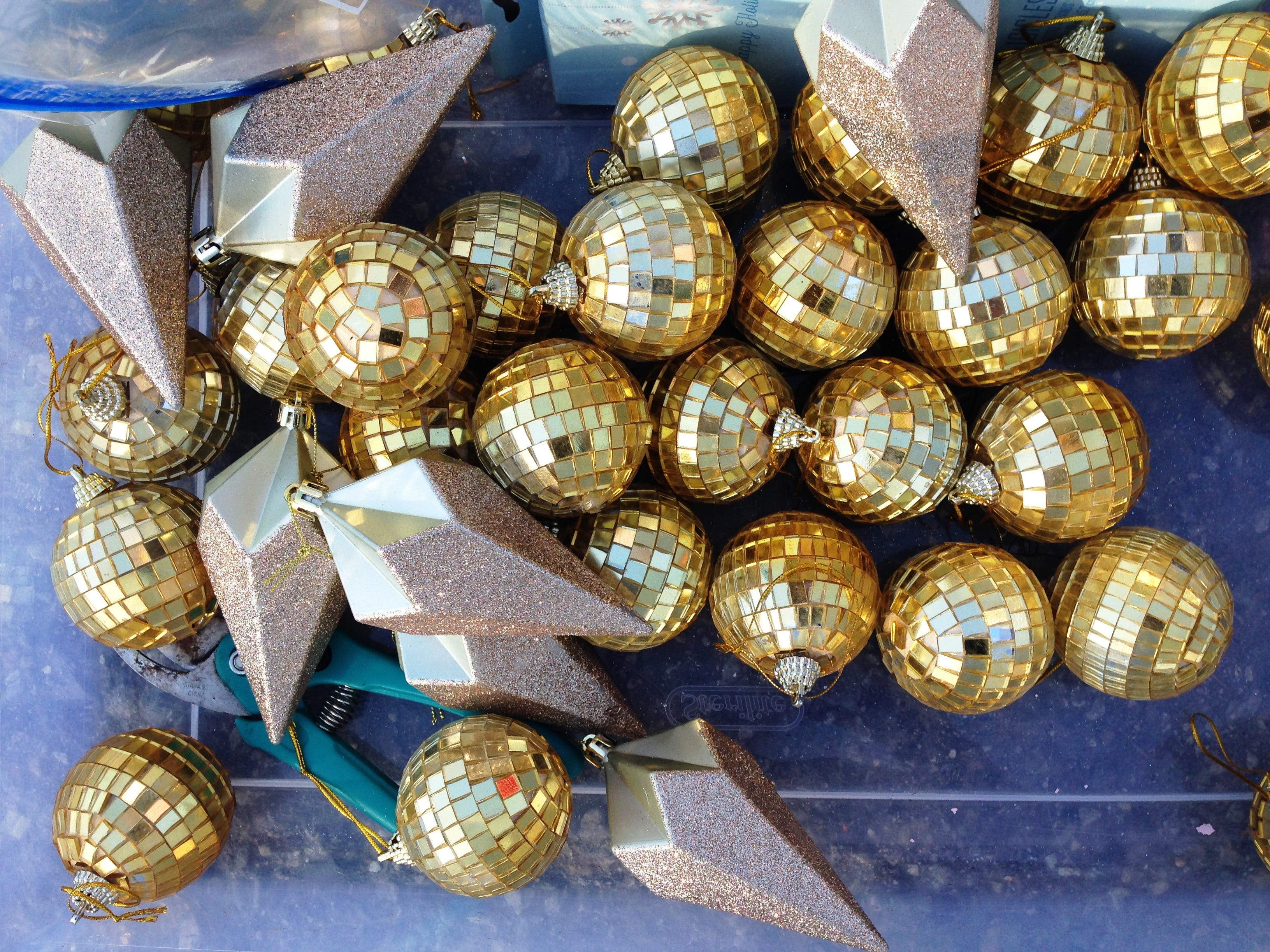 Gold disco balls are ready to hang on a Christmas tree sponsored by Fleur De Rye in Ventura. More than 100 elaborately decorated trees will be on display for Holidays at the Plaza, an event at Plaza Park in Ventura running Dec. 7 through Jan. 2