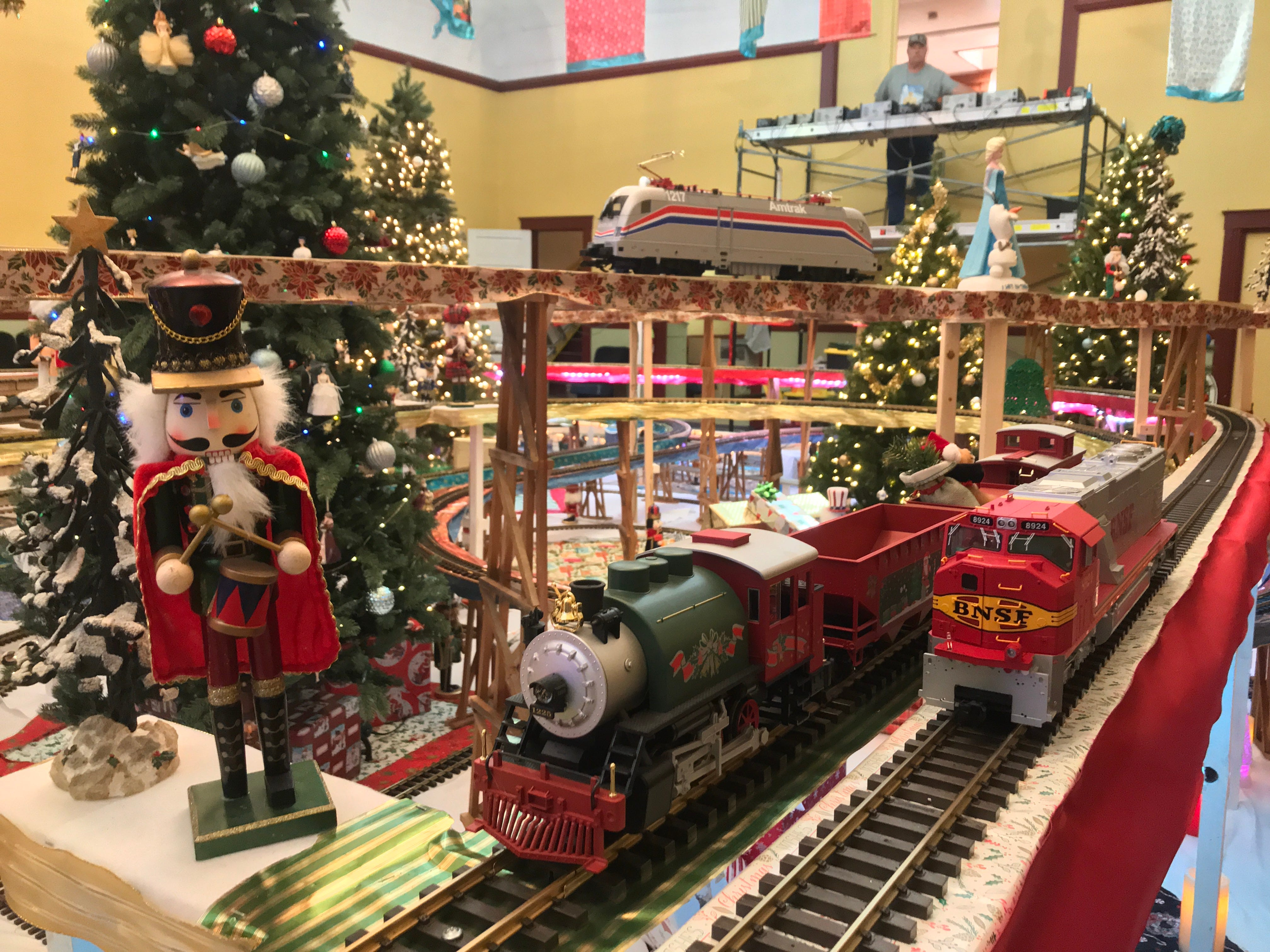 Trains go past a nutcracker in the Odd Fellows Christmas train display in Santa Paula.