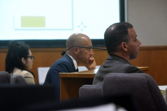 From right, Jeff Kay, detective at the Oxnard Police Department, defense attorney Michael Albers and defendant Marya Chavez listen as Omar Lopez, of Oxnard, testifies on Monday.