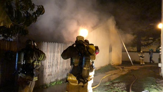 Firefighters attack heavy flames at an apartment unit complex in Ventura Monday night.