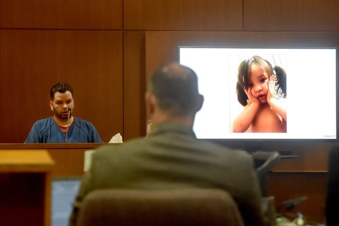 Omar Lopez, 33, of Oxnard, testifies on Monday at trial of Mayra Chavez, who has pleaded not guilty to second-degree murder charges in the death of their daughter. A photo of a young Kimberly was projected on a screen next to the witness stand.