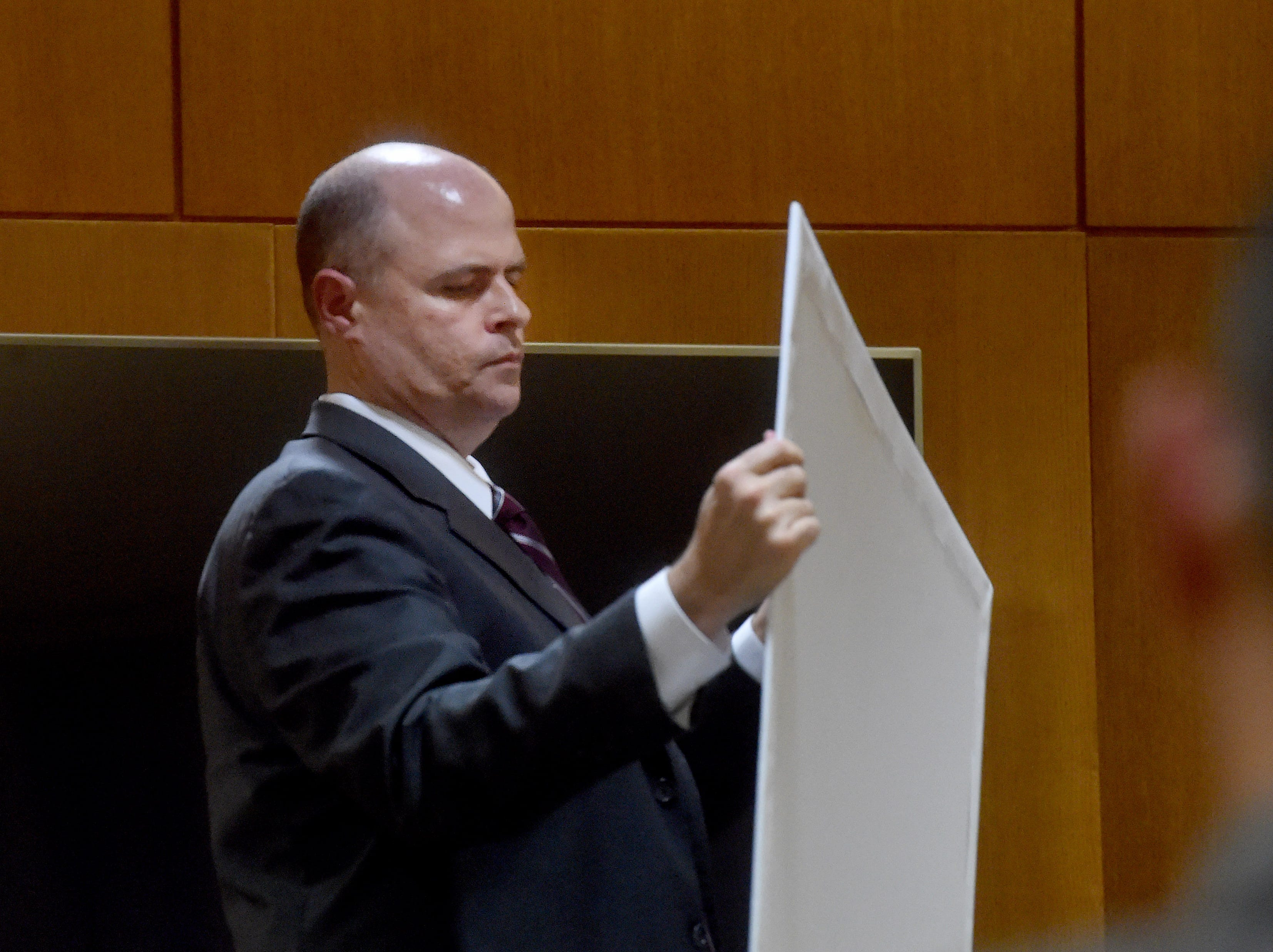 Senior Deputy District Attorney John Barrick shows evience to the jury as Omar Lopez, of Oxnard, testifies on Monday.