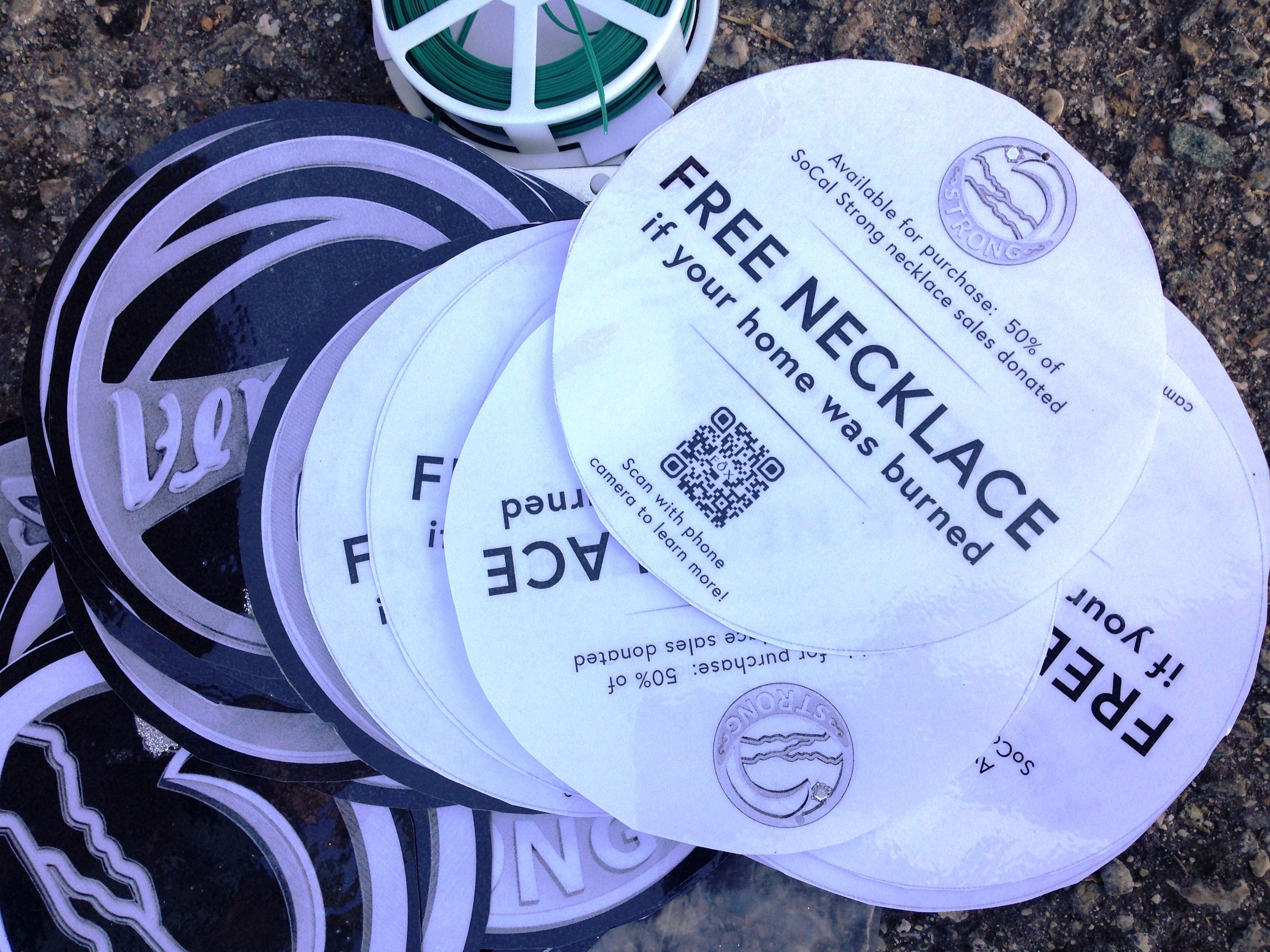 The tree sponsored by Fox Fine Jewelry is decorated with round paper ornaments with a QR code that people can scan for more information about free necklaces being given to those who lost their homes in the recent fires. More than 100 elaborately decorated trees will be on display for Holidays at the Plaza, an event at Plaza Park in Ventura running Dec. 7 through Jan. 2.