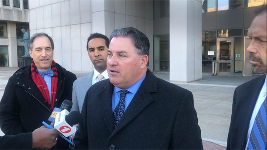 Michael Pizzi, center, with from left Ben Kuehne, Mount Vernon Mayor Richard Thomas and lawyer Douglas Martino after a Westchester judge permitted Pizzi and Kuehne to join Thomas' defense team on Dec. 3, 2018.