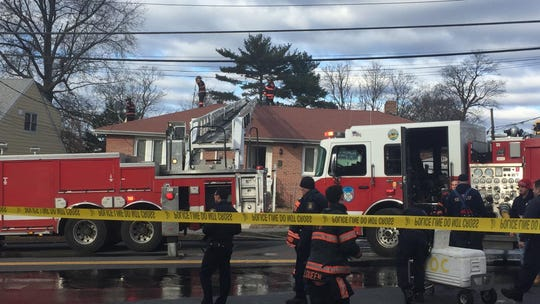 Yonkers firefighters knock down a blaze at 131 Park Ave. around 9 a.m. on Tuesday. Firefighters pulled a woman from the smoky apartment but she later died.