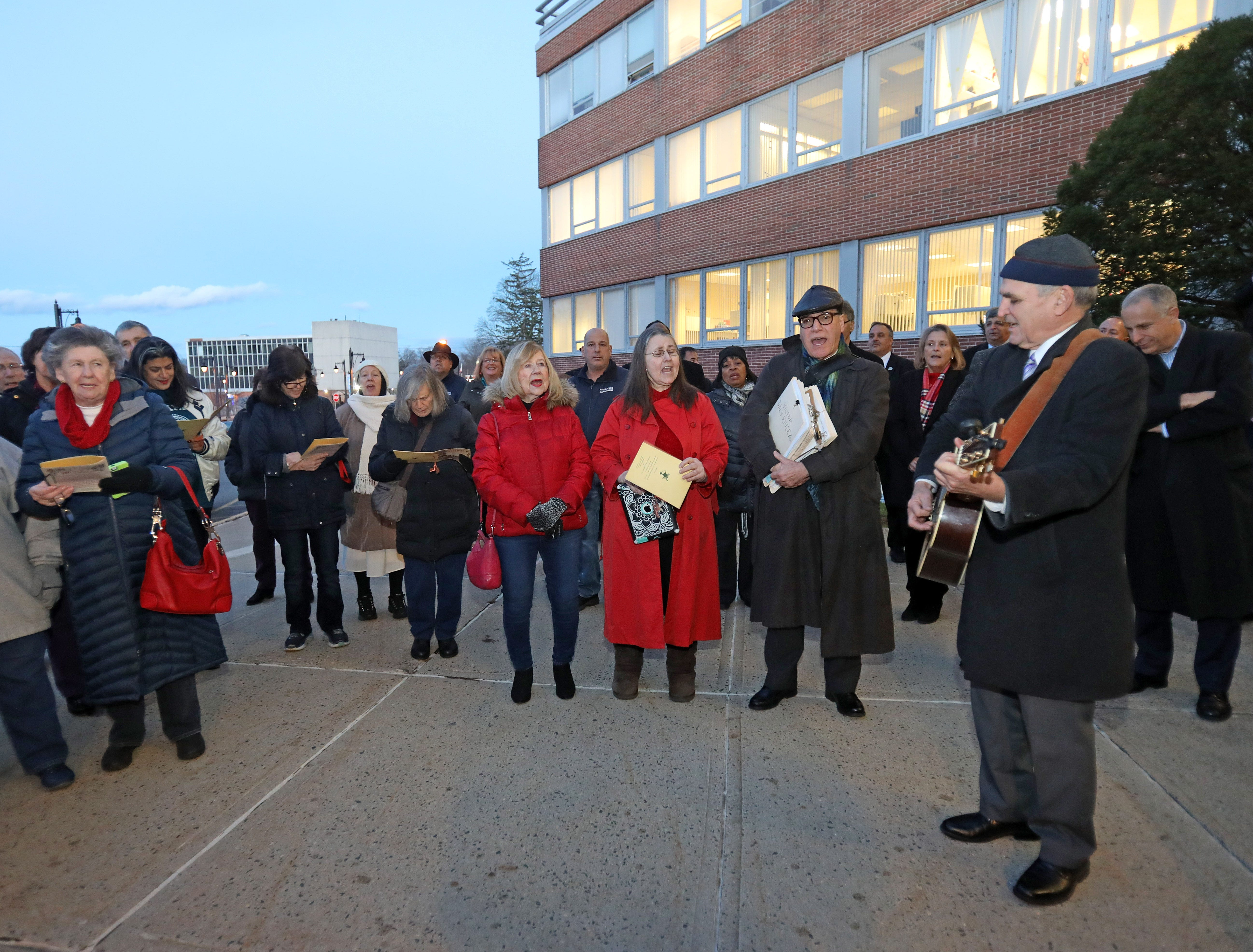 Local residents sing holiday songs during The Blessing of the Nativity Creche in front of the Rockland County Office Building in New City Dec. 3, 2018.