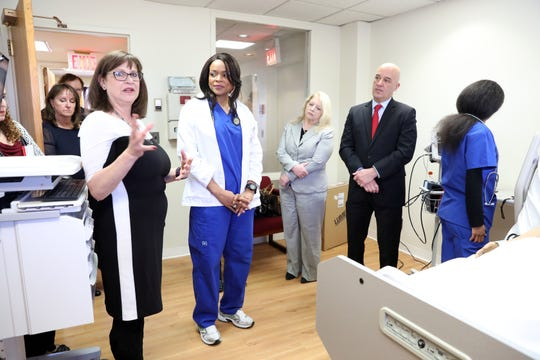 Debra Simons, left, the dean of the School of Nursing & Healthcare Professions program, gives a tour of the new clinical simulation lab at the College of New Rochelle Dec. 4, 2018.