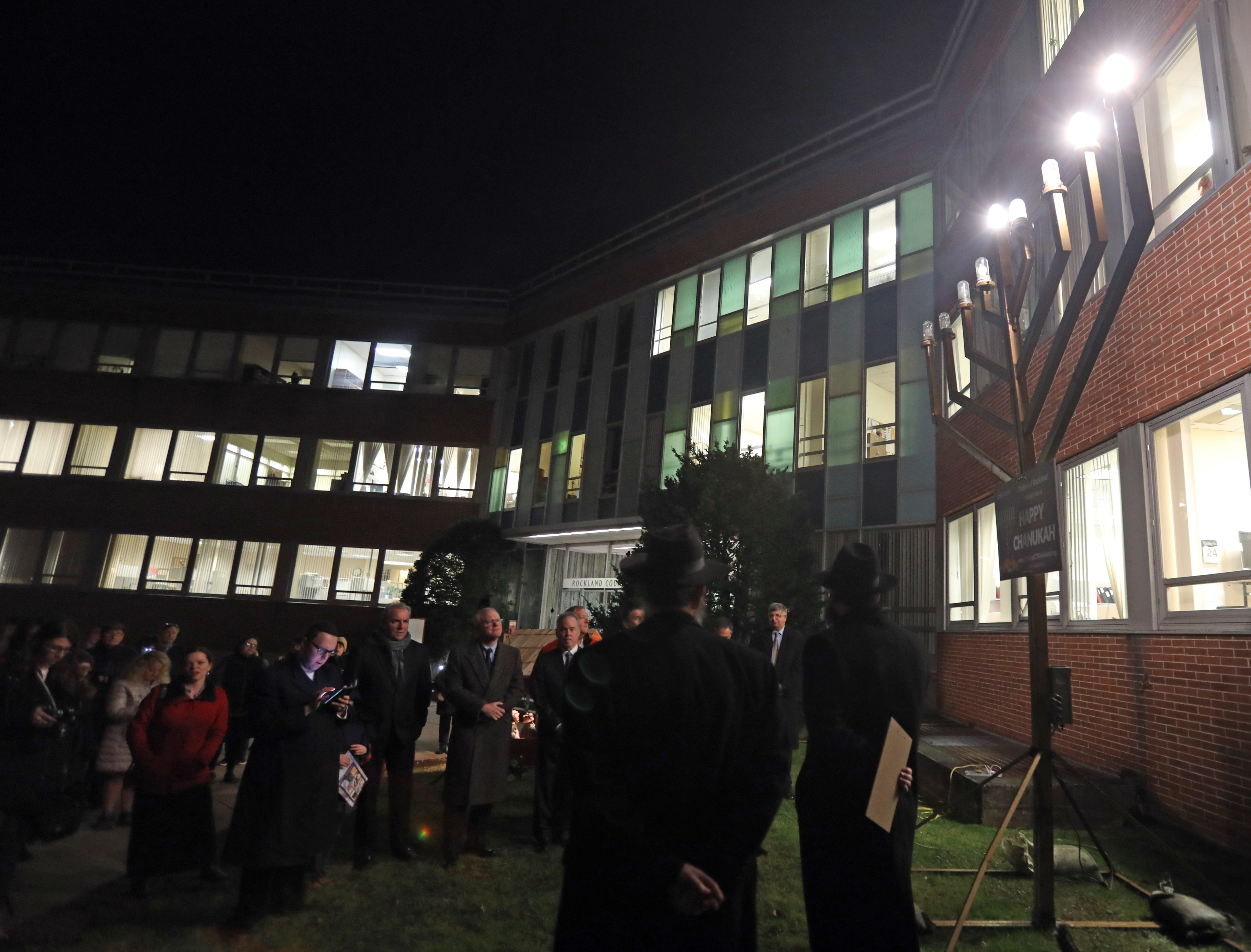 Rabbi Avremel Kotlarsky, regional director of Chabad Lubavitch of Rockland speaks during The Lighting of the Menorah on the second night of Hanukkah at the Rockland County Office Building in New City Dec. 3, 2018.