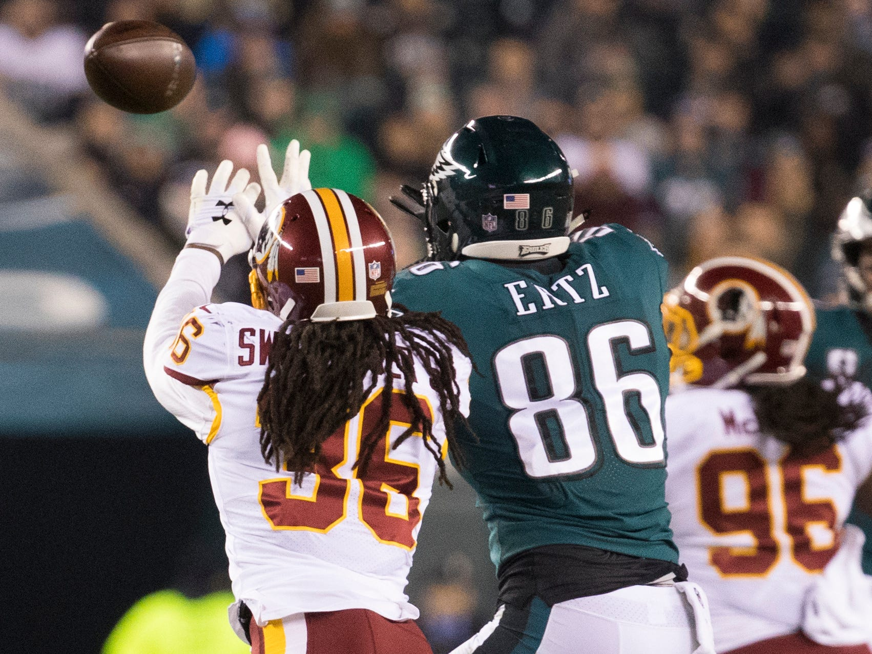 Eagles' Zach Ertzgoes up against Washington's D.J. Swearinger Jr. (36) Monday night.