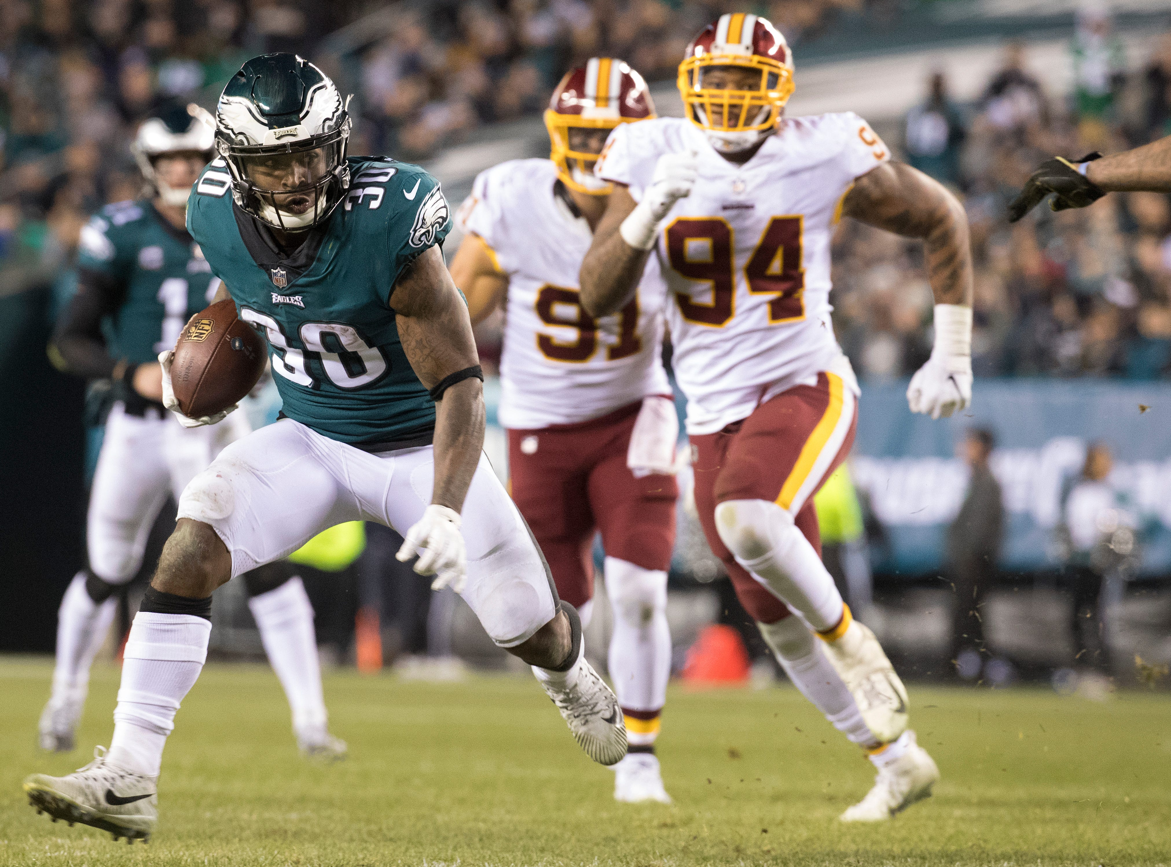 Eagles' Corey Graham (30) rushes downfield Monday night against the Redskins.