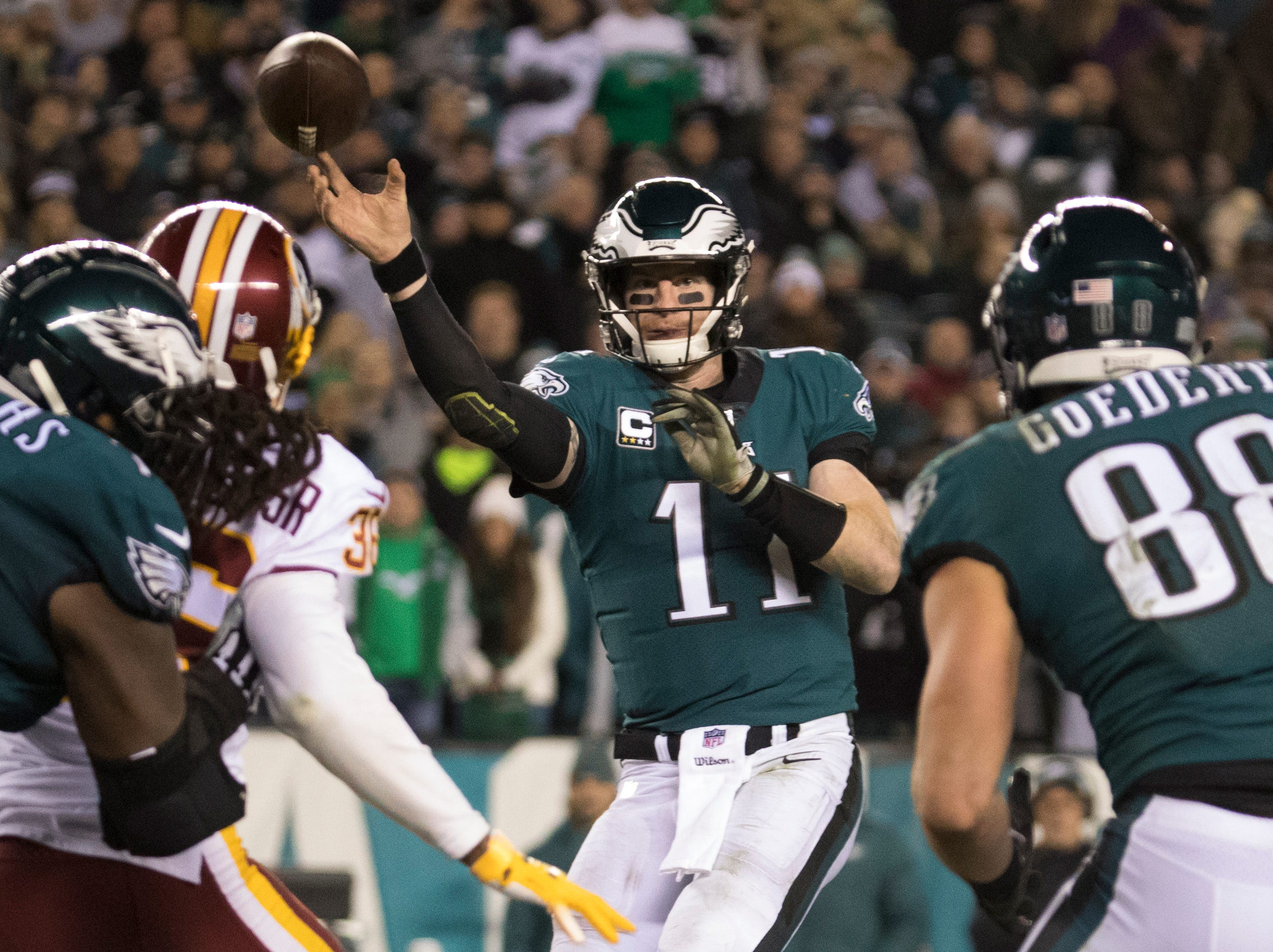 Eagles' Carson Wentz (11) throws towards the sideline Monday night against the Redskins