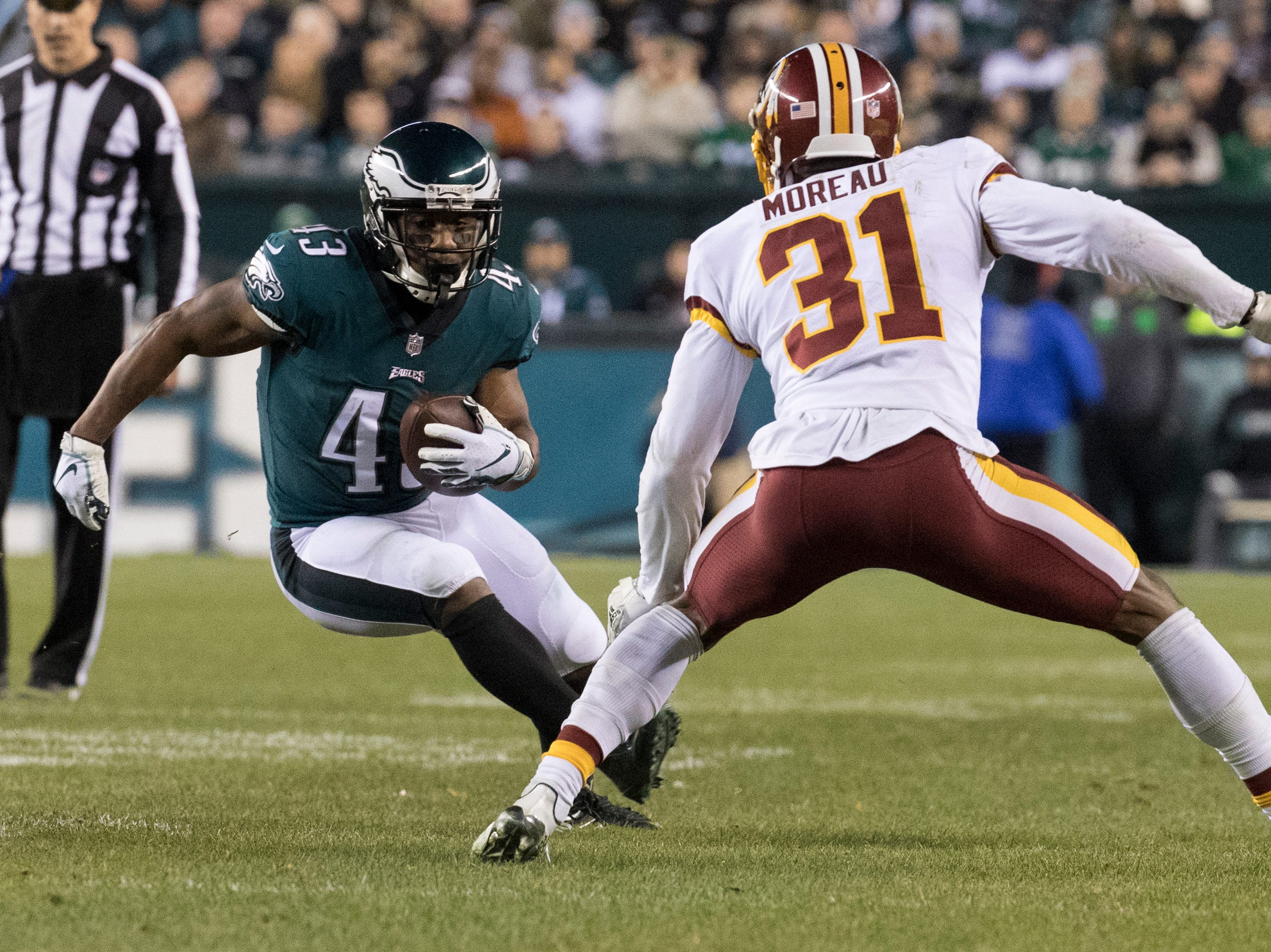 Eagles' Darren Sproles (43) cuts back against Washington's Fabian Moreau (31) Monday night.