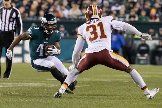 Eagles' Darren Sproles (43) cuts back against Washington's Fabian Moreau (31) during the Eagles' Dec. 3 game against the Redskins.