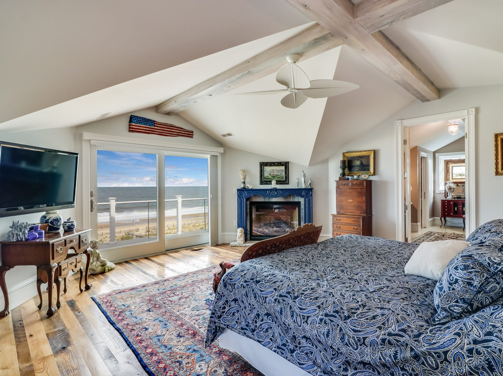 This bedroom at 18 Ocean Drive in North Beach features an angled and beamed ceiling and ocean views.