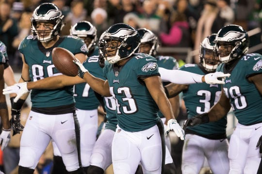 Eagles' Darren Sproles (43) celebrates scoring a touchdown this season against the Redskins.