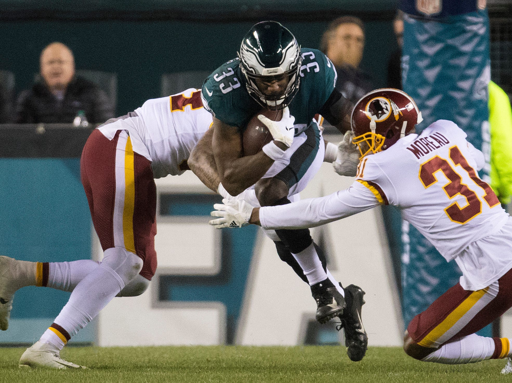 Eagles' Josh Adams (33) busts through the Washington defense Monday night.