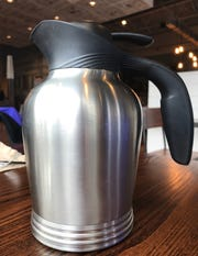 Servers bring and leave pots of coffee on the table at First Watch, a new breakfast-brunch-lunch restaurant near Stanton.