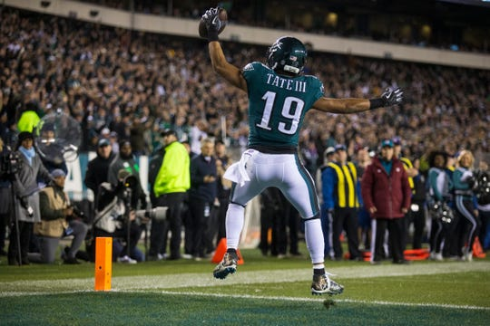 Eagles' Golden Tate jumps in the end zone after scoring a two-point conversion Monday night against the Redskins.