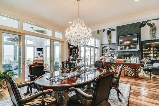 The dining room at 18 Ocean Drive is furnished with antiques.