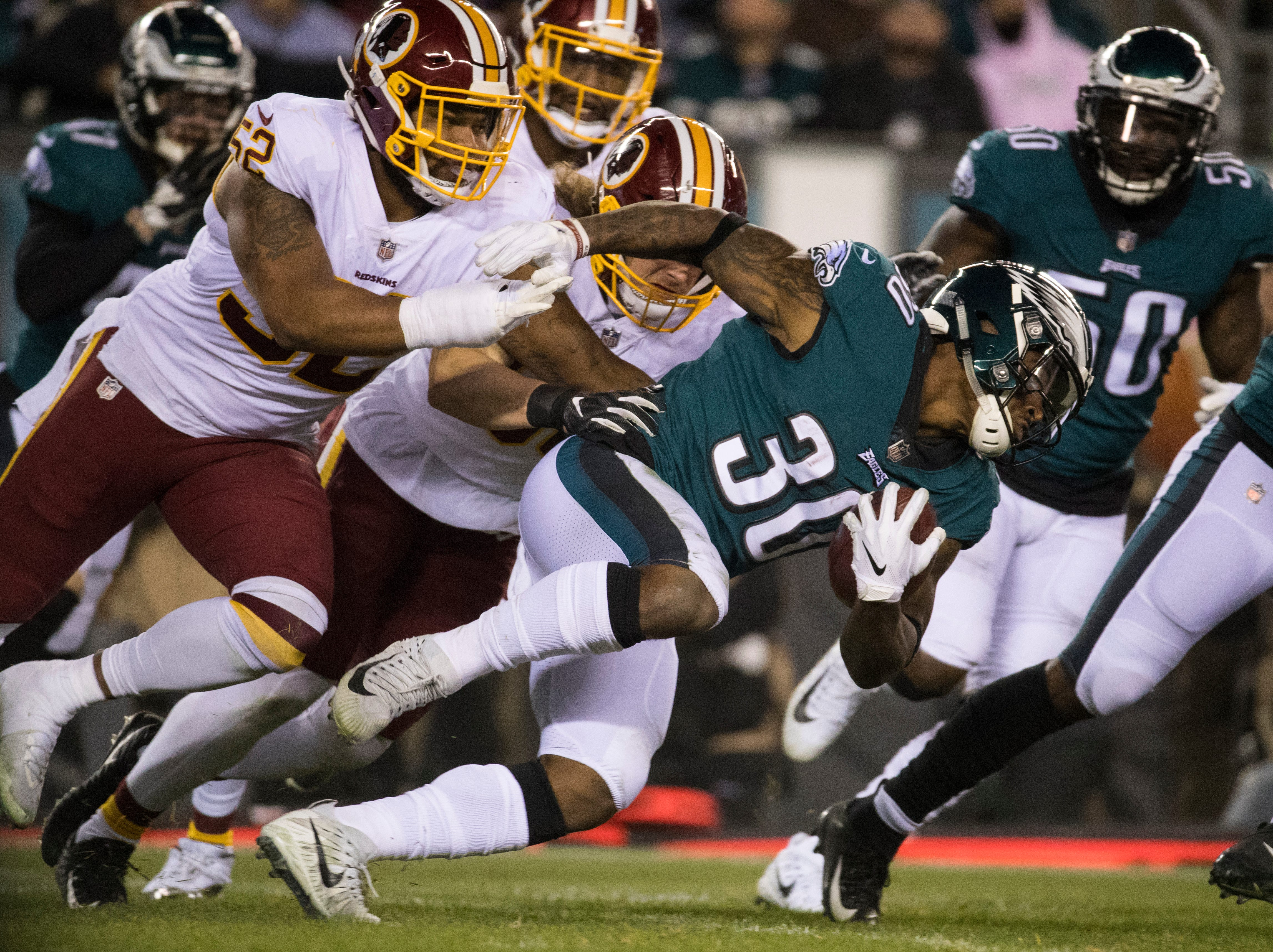 Eagles' Corey Clement (30) returns a kickoff Monday night against the Redskins.