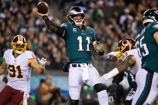 Eagles' Carson Wentz (11) throws downfield Monday night.