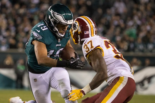 Eagles' Golden Tate (19) looks for room after a catch Monday night against the Redskins.