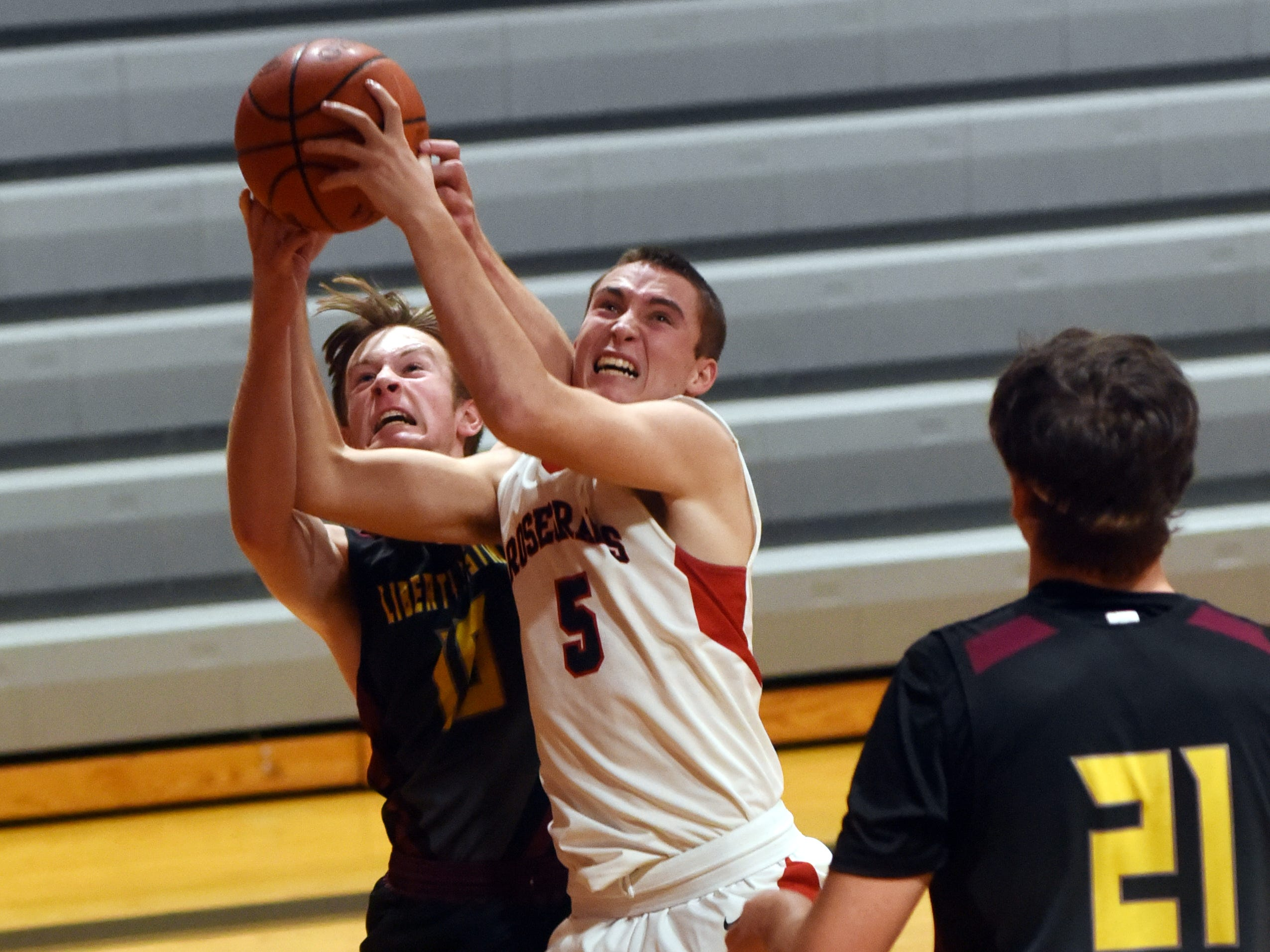Marcus Browning fights for a rebound during  Rosecrans' 92-12 win against Liberty Christian on Monday night at Rogge Gymnasium.
