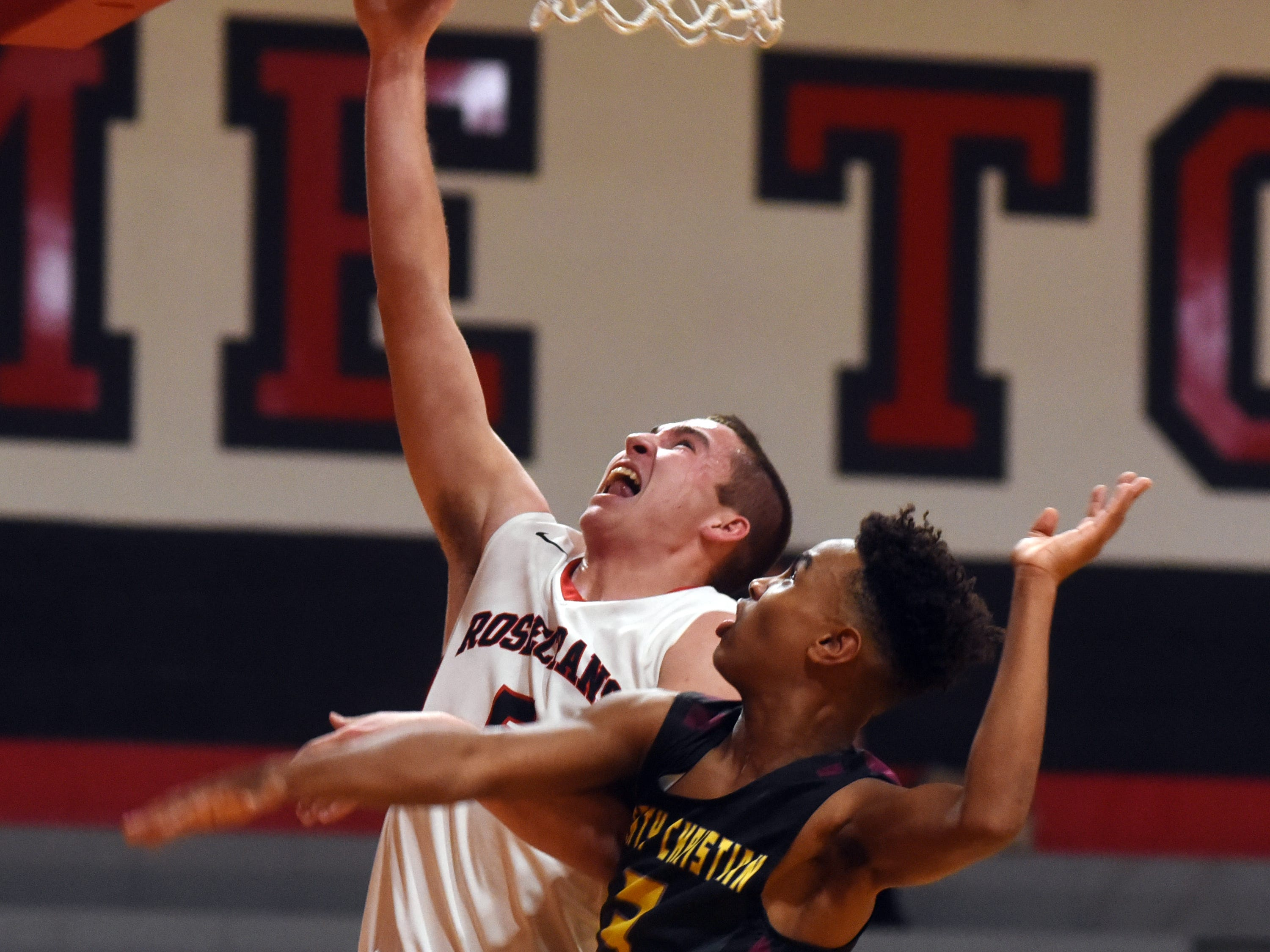 Rosecrans' Marcus Browning goes up for a layup in the second quarter against Liberty Christian on Monday night at Rogge Gymnasium.