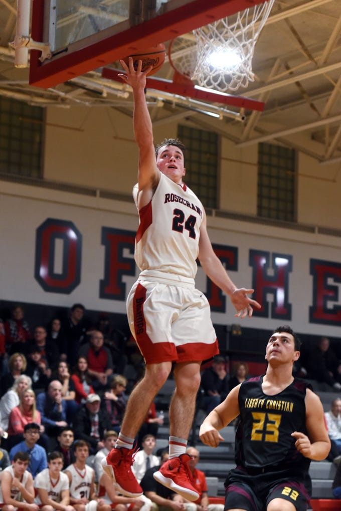 Weston Nern soars for a layup over Liberty Christian's Parker Kussmaul during Rosecrans' 92-12 win on Monday at Rogge Gymnasium. Nern and his teammates hope to improve on last season's 12-12 record.