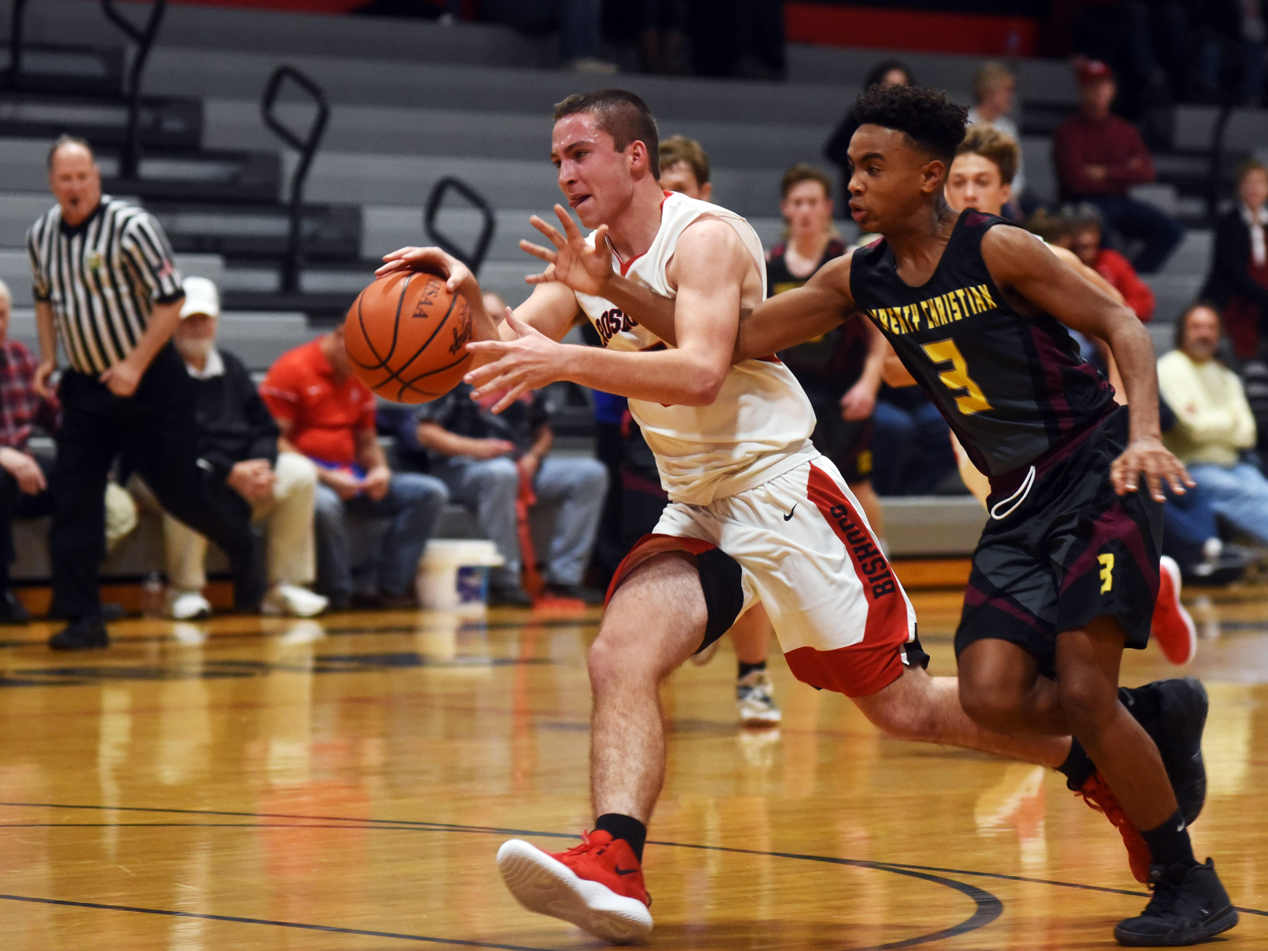 Rosecrans' Marcus Browning, left, steals the ball during the second quarter against Liberty Christian on Monday night at Rogge Gymnasium.