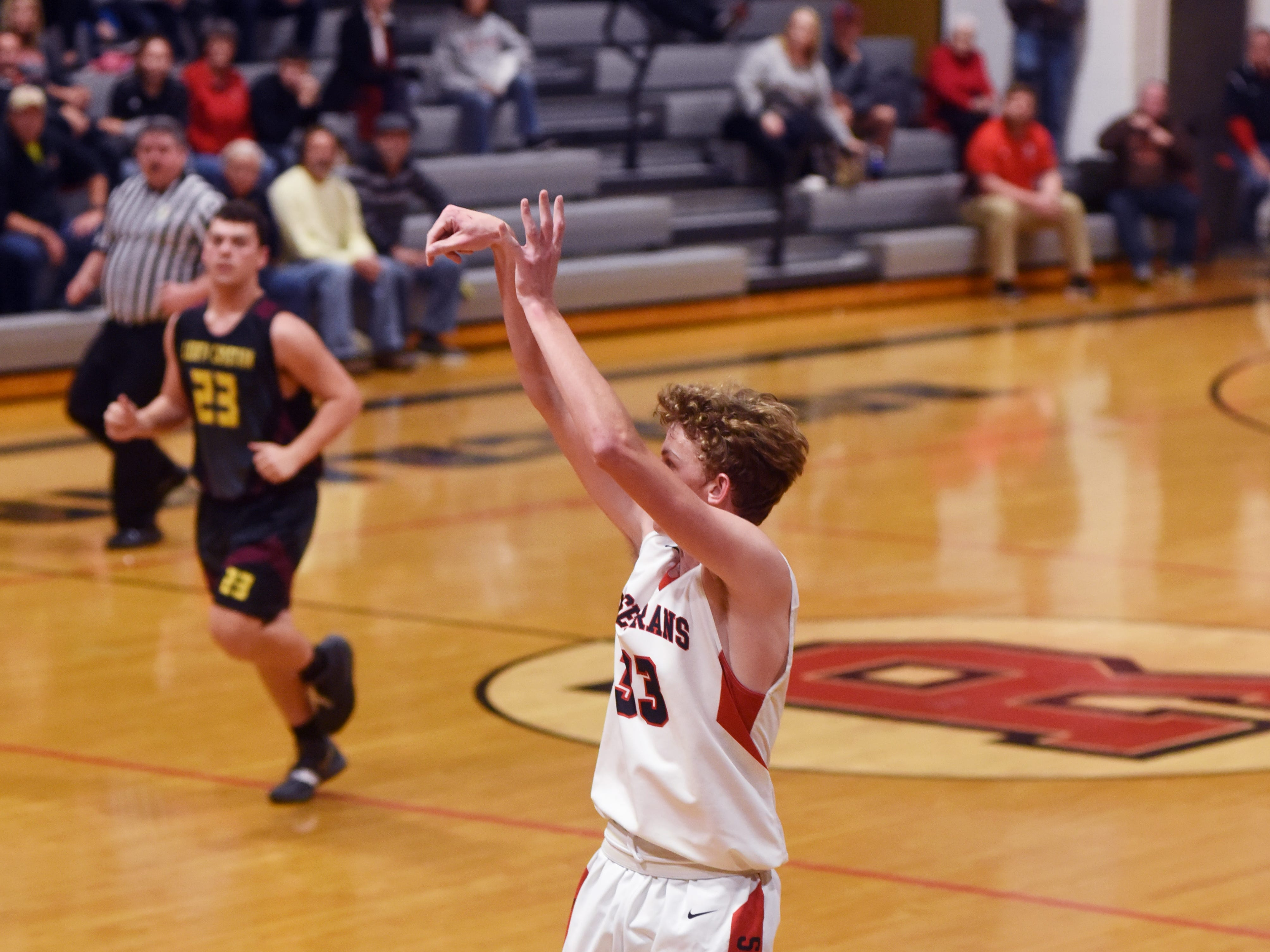 Kaid Brown hits a 3 during the first half of Rosecrans' 92-12 win against Liberty Christian on Monday night at Rogge Gymnasium.