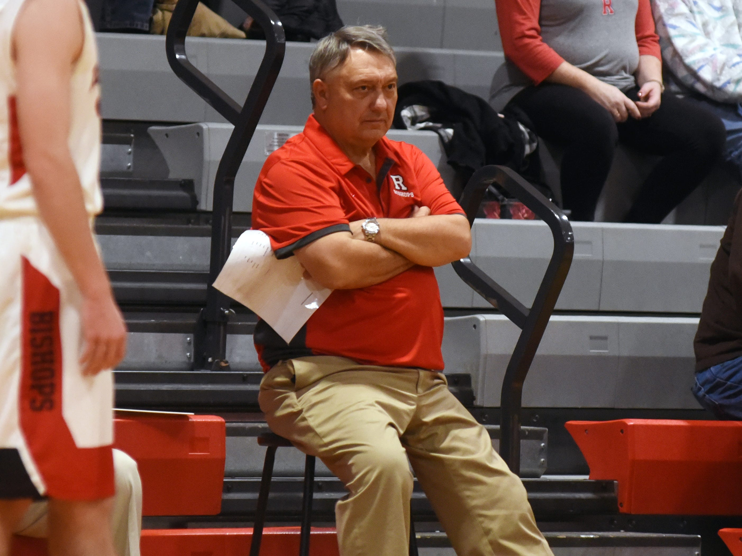Rosecrans coach Todd Rock watches his team play against Liberty Christian on Monday night at Rogge Gymnasium. Rock  is back to lead a high-energy group of Bishops in 2018-19.