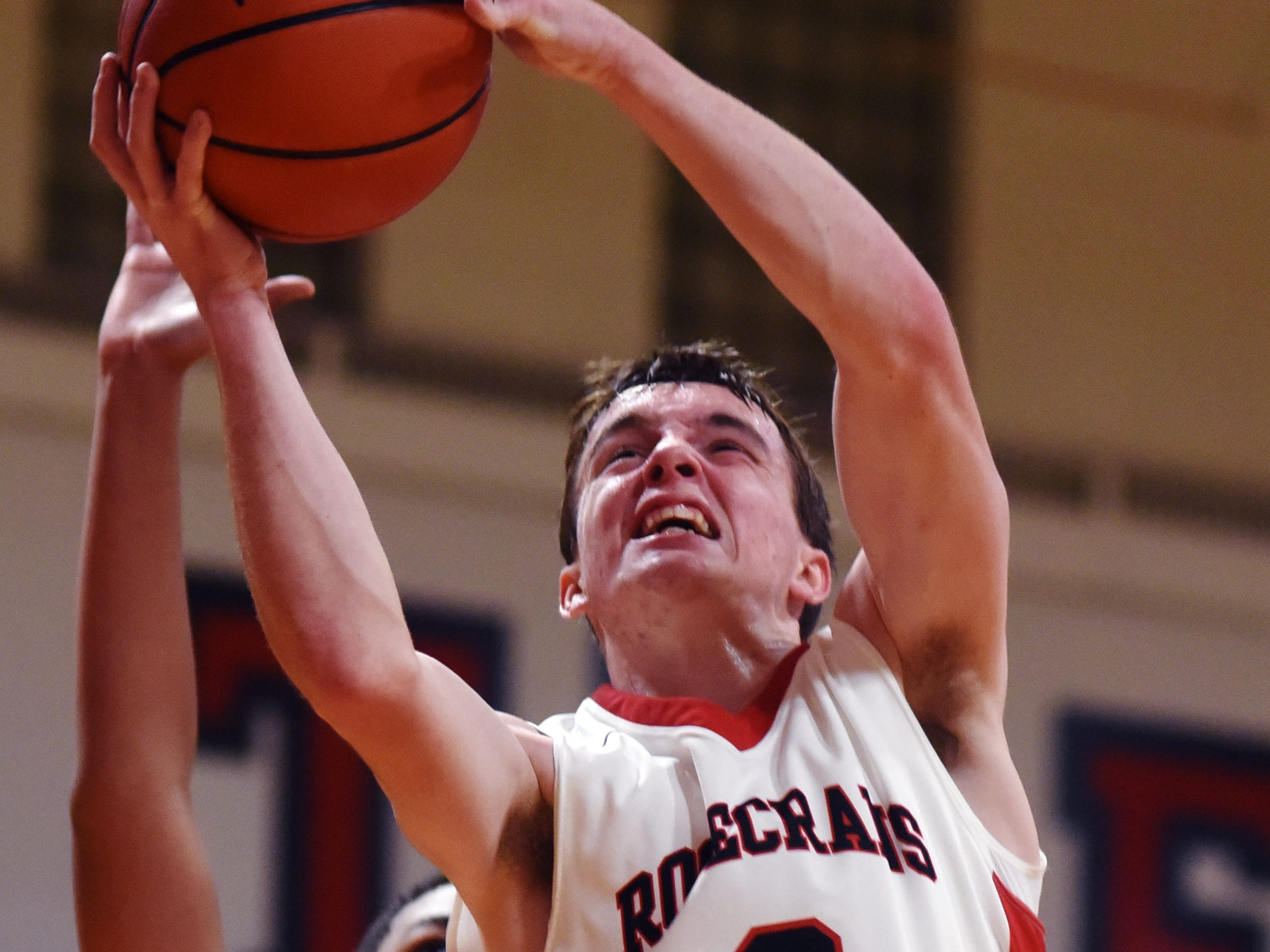 Weston Nern, of Rosecrans, fights for a rebound against Liberty Christian on Monday night at Rogge Gymnasium.