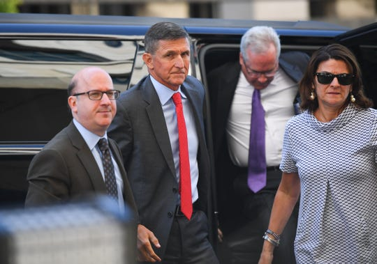 Lawyers escort Michael Flynn into a Washington court in July 2018.