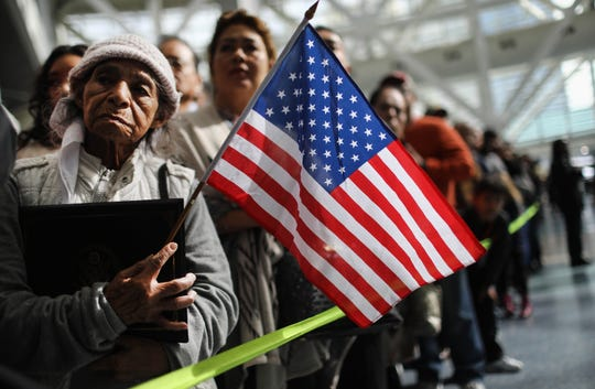 Ana Julia Ayala, an immigrant from El Salvador, waits for her son to depart a naturalization ceremony on March 20, 2018, in Los Angeles, California. The naturalization ceremony welcomed more than 7,200 immigrants from over 100 countries who took the citizenship oath and pledged allegiance to the American flag.