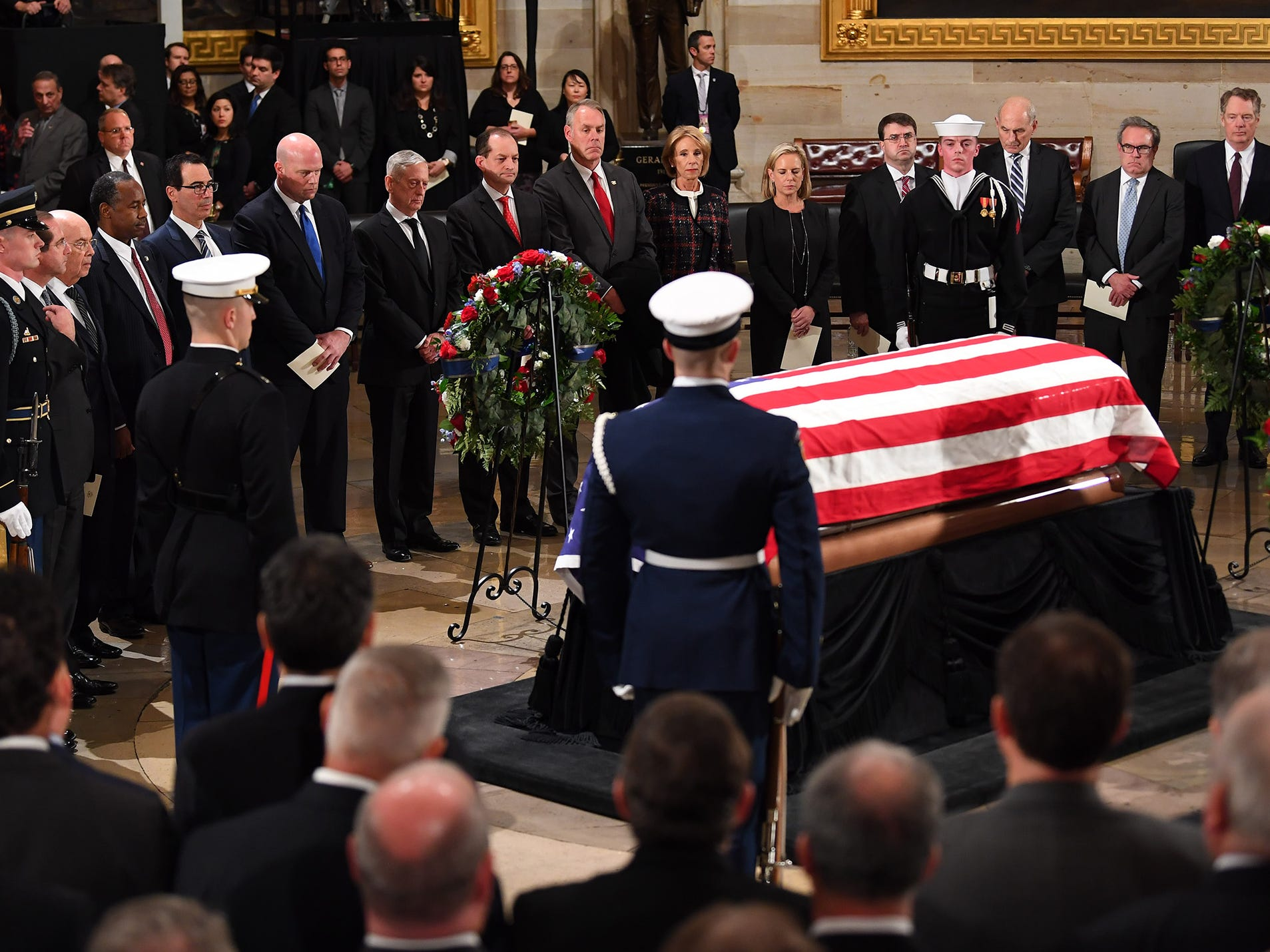 Current Cabinet members pay their respect to the former President George H.W. Bush lies at the U.S. Capitol Rotunda on Monday. The late president will lie in state until 7 a.m. Wednesday, Dec. 5, 2018.