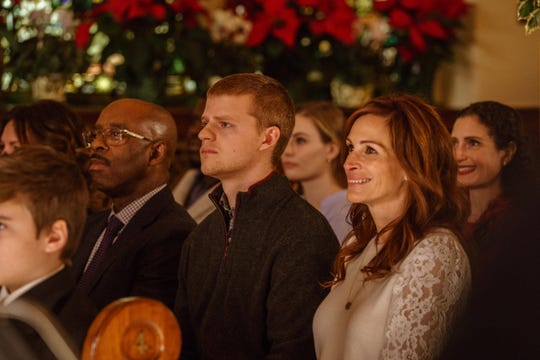 """Ben (Lucas Hedges, center) attends a Christmas pageant with stepfather Neal (Courtney B. Vance) and mother Holly (Julia Roberts) in """"Ben Is Back."""""""
