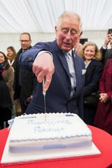 Prince Charles cuts a birthday cake while attending the Business in the Community Waste-to-Wealth Summit in London, Nov. 22, 2018.