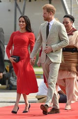 Prince Harry and Duchess Meghan of Sussex arrive in Tonga on Oct. 25, 2018, as part of their three-week royal tour of Down Under.