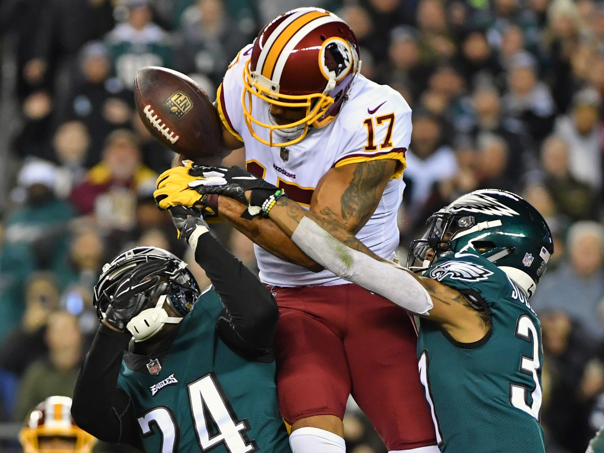 Philadelphia Eagles defensive back Tre Sullivan (37) and free safety Corey Graham (24) break up a pass intended for Washington Redskins wide receiver Michael Floyd (17) during the second quarter at Lincoln Financial Field.