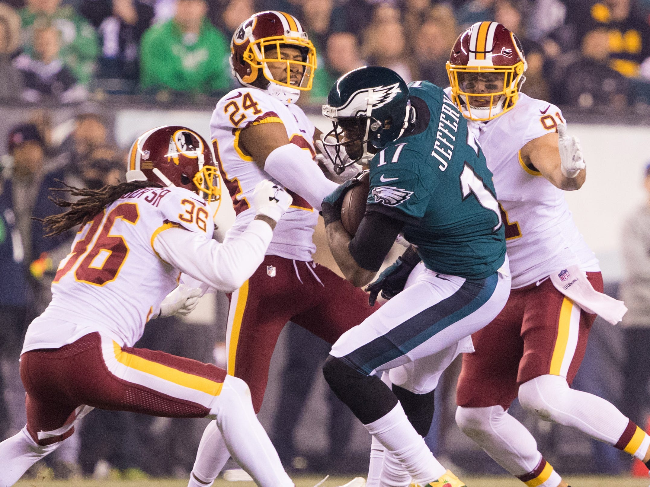 Philadelphia Eagles wide receiver Alshon Jeffery (17) makes a reception in front of Washington Redskins cornerback Josh Norman (24) and free safety D.J. Swearinger (36) during the first quarter at Lincoln Financial Field.